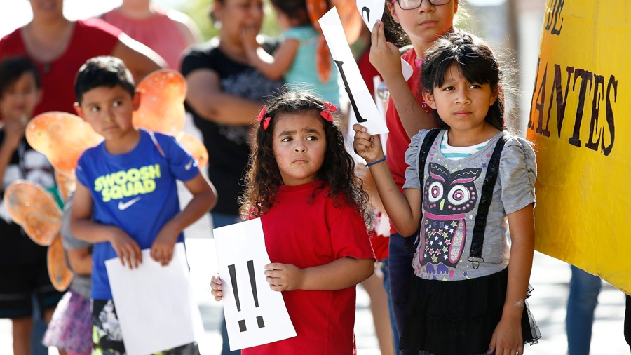 Children listen to speakers during an immigration family separation protest in front of the Sandra Day O'Connor U.S. District Court building, Monday, June 18, 2018, in Phoenix.  (AP /Ross D. Franklin)