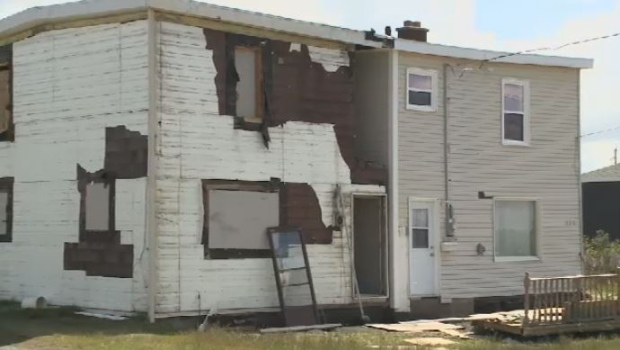 A Cape Breton woman's efforts to prevent the demolition of the neglected half of the duplex where she lives has taken a turn for the worse. Kim Losier says she will have to pay out more than $30,000 for unexpected repairs.