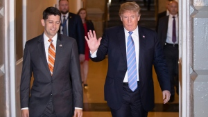 Speaker of the House Paul Ryan, R-Wis., left, walks with U.S. President Donald Trump as they head to a meeting of House Republicans to discuss a GOP immigration bill at the Capitol in Washington, Tuesday, June 19, 2018. (AP Photo/J. Scott Applewhite)