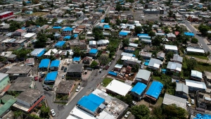 This June 18, 2018 photo shows an aerial view of the Amelia neighborhood in the municipality of Catano, east of San Juan, Puerto Rico. (AP Photo/Dennis M. Rivera)