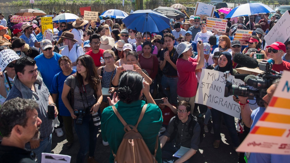 Protesters stand outside the U.S. Immigration and Customs Enforcement processing center in El Paso, Texas, Tuesday, June 19, 2018. (Ivan Pierre Aguirre/The San Antonio Express-News)