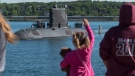 Family and friends greet HMCS Windsor, one of Canada's Victoria-class long range patrol submarines, as it returns to port in Halifax on Wednesday, June 20, 2018 after completing a 5-month deployment in the Euro-Atlantic region.  THE CANADIAN PRESS/Andrew Vaughan