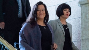 Minister of Justice and Attorney General of Canada Jody Wilson-Raybould, centre, Minister of Health Ginette Petitpas Taylor, right, and Parliamentary Secretary to the Minister of Justice and Attorney General of Canada and to the Minister of Health Bill Blair, behind, arrive for a press conference on Bill C-45, the Cannabis Act, in the Foyer of the House of Commons on Parliament Hill in Ottawa on Wednesday, June 20, 2018. THE CANADIAN PRESS/Justin Tang