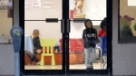 Immigrants recently processes and released by U.S. Customs and Border Protection wait at the the Catholic Charities RGV, Wednesday, June 20, 2018, in McAllen, Texas. (AP Photo/Eric Gay)
