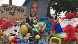 Toys and protest signs left outside Immigration Minister Ahmed Hussen's constituency office. (Photo: Twitter/Petra Molnar)