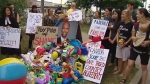 Toy Pile of shame outside Minister Hussen office