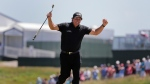 In this June 17, 2018, file photo, Phil Mickelson reacts after sinking a putt on the 13th hole during the final round of the U.S. Open Golf Championship, in Southampton, N.Y. (AP Photo/Frank Franklin II)