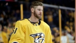In this Jan. 21, 2018, file photo, Nashville Predators left wing Austin Watson warms up before an NHL hockey game against the Florida Panthers, in Nashville, Tenn. (AP Photo/Mark Humphrey, File)
