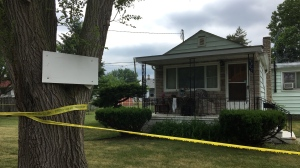 Police tape surrounds a home after a homicide at 1497 Everts Ave., in Windsor, Ont., on Wednesday, June 20, 2018. (Ricardo Veneza / CTV Windsor)