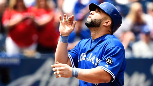 Toronto Blue Jays designated hitter Kendrys Morales (8) celebrates his two-run home run against the Atlanta Braves during first inning interleague baseball action in Toronto on Wednesday, June 20, 2018. (THE CANADIAN PRESS/Nathan Denette)