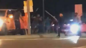 A group of people are seen in this video footage clip assaulting each other using what appears to be baseball bats. (Matthew Amini)