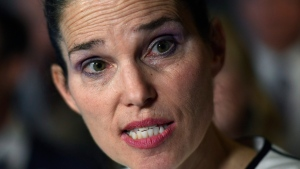 Minister of Science, Sport and Persons with Disabilities Kirsty Duncan makes an announcement on the elimination of harassment, abuse and discrimination in sport in the Foyer of the House of Commons on Parliament Hill in Ottawa on Tuesday, June 19, 2018. (THE CANADIAN PRESS/Justin Tang)