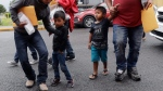 Young immigrants and arrive with their parents at the Catholic Charities RGV after they were processed and released by U.S. Customs and Border Protection, Tuesday, June 19, 2018, in McAllen, Texas. (AP Photo / Eric Gay)