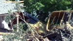 Man pleads guilty after bulldozing home