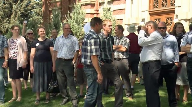 Opponents of Alberta's law prohibiting schools from disclosing GSA participation to parents gathered outside of the Medicine Hat courthouse on June 20, 2018