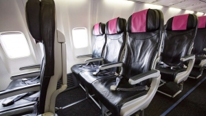 The cabin of a Swoop Airlines Boeing 737 on display during a media event, Tuesday, June 19, 2018 at John C. Munro International Airport in Hamilton, Ont. Rows near the front of the plane have extra leg space for passengers. THE CANADIAN PRESS/Tara Walton