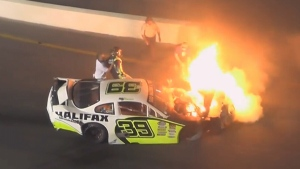 Extended: Dad saves son from race car fire