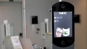 In this July 12, 2017 file photo, a U.S. Customs and Border Protection facial recognition device is ready to scan another passenger at a United Airlines gate at George Bush Intercontinental Airport, in Houston. (AP Photo/David J. Phillip, File)