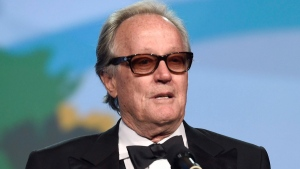 In this Jan. 2, 2018 file photo, Peter Fonda presents the Desert Palm achievement award at the 29th annual Palm Springs International Film Festival in Palm Springs, Calif. (Photo by Chris Pizzello/Invision/AP)