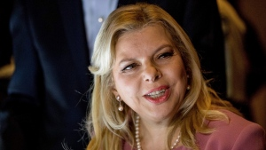In this Feb. 15, 2017 file photo, Sara Netanyahu, wife of Israeli Prime Minister Benjamin Netanyahu, tours the Smithsonian's National Museum of African American History and Culture in Washington with first lady Melania Trump. (AP Photo/Andrew Harnik, File)