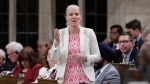 Minister of Environment and Climate Change Catherine McKenna speaks during question period in the House of Commons on Parliament Hill in Ottawa on Thursday, June 14, 2018. THE CANADIAN PRESS/David Kawai