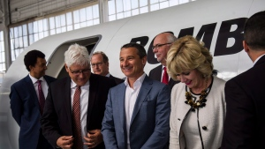 Front row from left: Francios Caza, Mike Nadolski and Ann Buller gather with academic, corporate and public representatives for a photo after Bombardier's announcement of the creation of an aerospace innovation hub in Downsview park in Toronto, on June 21, 2018. THE CANADIAN PRESS/Christopher Katsarov
