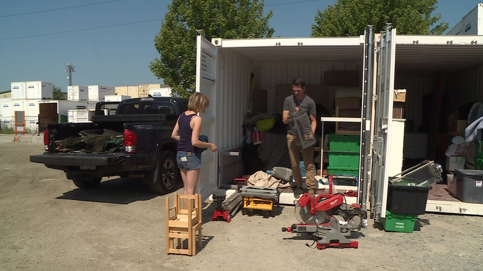 Todd Talbot and his wife Rebecca sort through things to move. (CTV)