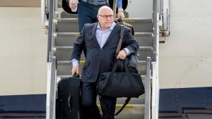 In this June 8, 2018, file photo, Washington Capitals head coach Barry Trotz arrives with the team at Dulles International Airport in Sterling, Va., the day after defeating the Vegas Golden Knights in Game 5 of the NHL hockey Stanley Cup Finals. (AP Photo/Andrew Harnik, File)
