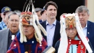 Prime Minister Justin Trudeau is led out to an event by Indigenous drummers in Prince Rupert, B.C. on Thursday, June 21, 2018. (Jonathan Hayward  / THE CANADIAN PRESS)