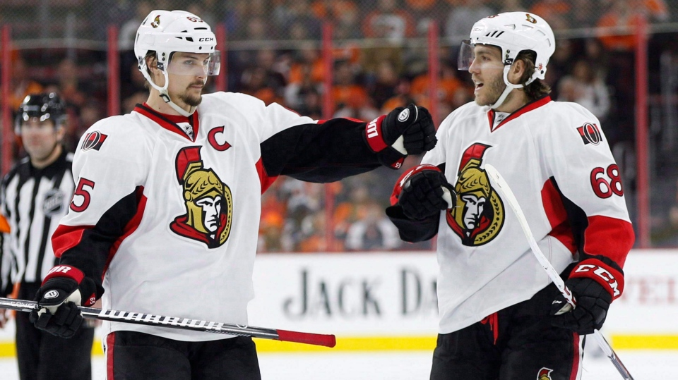 Ottawa Senators' Mike Hoffman (68) celebrates his power play goal with Erik Karlsson (65), of Sweden, during the third period of an NHL hockey game against the Philadelphia Flyers, Saturday, April 2, 2016, in Philadelphia. (THE CANADIAN PRESS/AP/Chris Szagola)