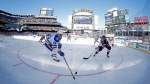 Buffalo Sabres center Jack Eichel (15) controls the puck in front of New York Rangers defenseman Ryan McDonagh (27) in the first period of the NHL Winter Classic hockey game at CitiField in New York on Monday, Jan. 1, 2018. (AP Photo/Adam Hunger)