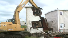 Kim Losier is furious about what it has cost her to deal with a derelict home that is the other half of her Glace Bay duplex.
