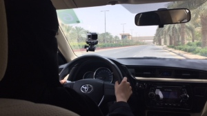 Ahlam Alquout learns to drive from an instructor at Princess Nourah Bint Abdulrahman University in Riyadh, Saudi Arabia, as her country prepares to lift a ban on women drivers this week.