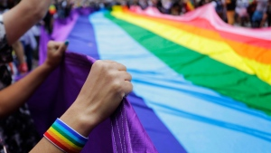 Revelers at the annual gay pride parade hold up a giant rainbow flag in Sao Paulo, Brazil, Sunday, June 3, 2018. (AP Photo/Nelson Antoine)