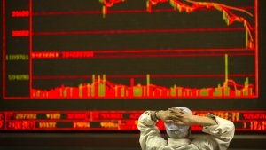 Chinese investors monitor stock prices at a brokerage house in Beijing, Friday, June 22, 2018. (AP Photo/Mark Schiefelbein)