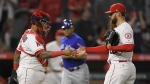 Los Angeles Angels catcher Martin Maldonado, left, and relief pitcher Justin Anderson congratulate each other after the Angels defeated the Toronto Blue Jays 8-5 in a baseball game in Anaheim, Calif. on Thursday, June 21, 2018. (AP Photo/Mark J. Terrill)
