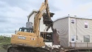 Half of a duplex is torn down in Glace Bay, N.S. on June 21, 2018.