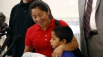 Beata Mariana de Jesus Mejia-Mejia, left, embraces her son Darwin Micheal Mejia as she speaks at a news conference following their reunion at Baltimore-Washington International Thurgood Marshall Airport in Linthicum, Md. on Friday, June 22, 2018. (AP Photo/Patrick Semansky)