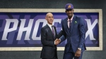 Arizona's Deandre Ayton, right, poses with NBA Commissioner Adam Silver after he was picked first overall by the Phoenix Suns during the NBA basketball draft in New York, Thursday, June 21, 2018. (AP Photo/Kevin Hagen)