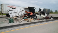 Police say one driver has died after a crash between two tractor trailers on Highway 401 near Tilbury, Ont., on Friday, June 22, 2018. (Courtesy OPP)