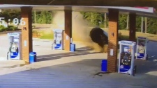 Car goes airborne while crashing into gas station