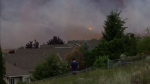 At a least a dozen properties were evacuated as a grass fire flared up in Kamloops, B.C. Thursday.
