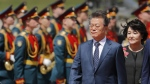 South Korean President Moon Jae-in and his wife Kim Jung-sook, right, at Moscow's Government Vnukovo airport, Russia, on June 21, 2018. (Alexander Zemlianichenko / AP)
