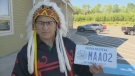 Chief Wilbert Marshall of the Assembly of Nova Scotia Mi'Kmaq Chiefs shows off the province's new Mi'kmaq licence plate in Truro, N.S. on June 22, 2018.