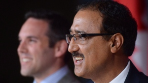 Amarjeet Sohi, right, and Currie Dixon at the National Press Theatre in Ottawa on June 22, 2016. (Sean Kilpatrick / THE CANADIAN PRESS)