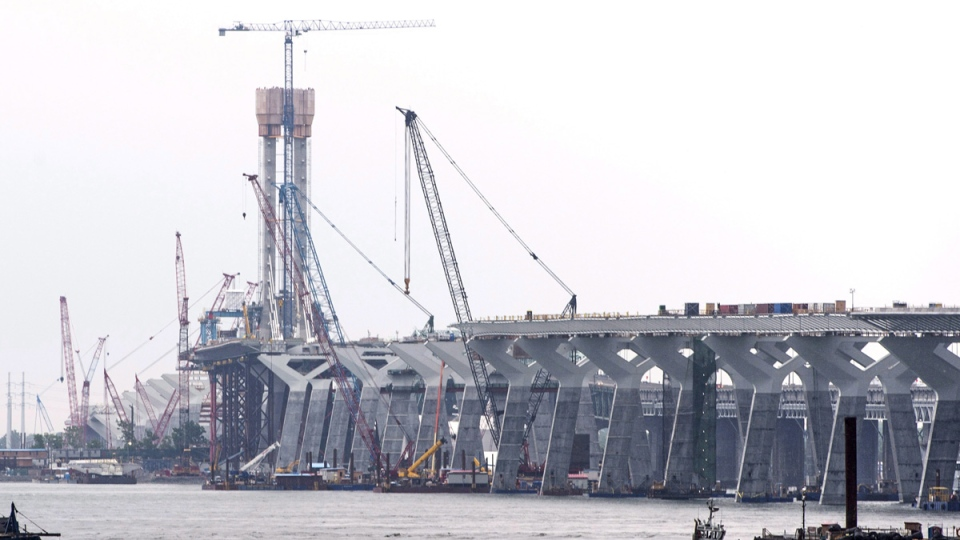 Cranes are at a standstill on the construction site of the new Champlain bridge in Montreal on June 18, 2018. (Paul Chiasson / THE CANADIAN PRESS)