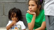Angui Funes, right, sits with her brother, Jesus, after crossing the border back to Reynosa, Mexico, Thursday, June 21, 2018. (AP Photo/David J. Phillip)