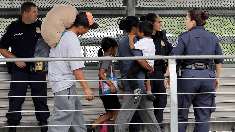 Immigrant family escorted across the U.S. border