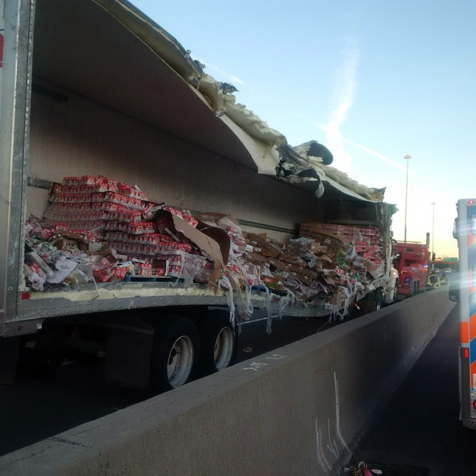 Police say cleanup efforts are underway after a transport truck collision that spilled yogurt onto a busy stretch of highway 401 in Toronto's east end. (Ontario Provincial Police)
