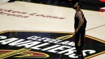 In this June 8, 2018, file photo, Cleveland Cavaliers' LeBron James watches during the first half of Game 4 of basketball's NBA Finals against the Golden State Warriors, in Cleveland. (AP Photo/Tony Dejak, File)